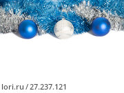 Купить «Christmas decorations of blue and silver color on a white background - balls and tinsel», фото № 27237121, снято 24 ноября 2017 г. (c) Юлия Бабкина / Фотобанк Лори