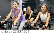Купить «Sporty women on cardio training on exercycles in health club», видеоролик № 27237301, снято 28 июля 2017 г. (c) Яков Филимонов / Фотобанк Лори