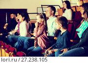Купить «Audience attending movie night for comedy», фото № 27238105, снято 3 декабря 2016 г. (c) Яков Филимонов / Фотобанк Лори