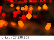 Купить «Abstract bokeh background of lights red and orange on a dark», фото № 27238865, снято 26 ноября 2017 г. (c) Юлия Бабкина / Фотобанк Лори