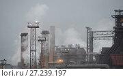 Купить «View of the metallurgical plant. Manufacture of cast iron and steel.», видеоролик № 27239197, снято 18 ноября 2017 г. (c) Андрей Радченко / Фотобанк Лори