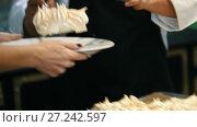 Купить «Chef putting dessert on plate - sweet Pavlova cake», видеоролик № 27242597, снято 30 мая 2020 г. (c) Константин Шишкин / Фотобанк Лори