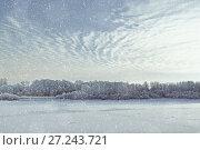 Купить «Winter landscape. Snowy winter trees along the frozen river at sunset. Winter nature», фото № 27243721, снято 12 декабря 2017 г. (c) Зезелина Марина / Фотобанк Лори