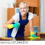 Купить «Young maid cleaning at apartment», фото № 27244813, снято 22 апреля 2019 г. (c) Яков Филимонов / Фотобанк Лори