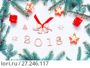 Купить «New Year 2018 background with 2018 figures,Christmas toys, fir branches-New Year 2018 composition», фото № 27246117, снято 30 ноября 2016 г. (c) Зезелина Марина / Фотобанк Лори