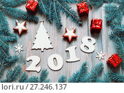 Купить «New Year 2018 background -2018 figures, Christmas toys, blue fir tree branches. New Year 2018 still life in cold tones», фото № 27246137, снято 29 ноября 2016 г. (c) Зезелина Марина / Фотобанк Лори