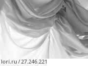 Купить «White tulle curtain with waving pattern», фото № 27246221, снято 22 октября 2017 г. (c) EugeneSergeev / Фотобанк Лори