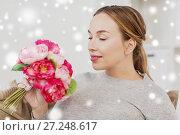 Купить «happy woman smelling flowers at home», фото № 27248617, снято 24 ноября 2016 г. (c) Syda Productions / Фотобанк Лори