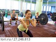 Купить «group of people training with barbells in gym», фото № 27248813, снято 19 февраля 2017 г. (c) Syda Productions / Фотобанк Лори