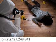 Купить «criminalist photographing dead body at crime scene», фото № 27248841, снято 5 мая 2017 г. (c) Syda Productions / Фотобанк Лори