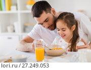Купить «happy family eating flakes for breakfast at home», фото № 27249053, снято 19 октября 2017 г. (c) Syda Productions / Фотобанк Лори