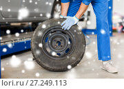 Купить «auto mechanic changing car tire at workshop», фото № 27249113, снято 1 июля 2016 г. (c) Syda Productions / Фотобанк Лори