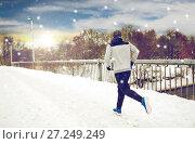 Купить «man running along snow covered winter bridge road», фото № 27249249, снято 10 ноября 2016 г. (c) Syda Productions / Фотобанк Лори