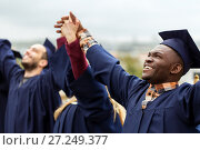Купить «happy students celebrating graduation», фото № 27249377, снято 24 сентября 2016 г. (c) Syda Productions / Фотобанк Лори