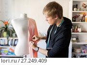 Купить «fashion designer with dummy making dress at studio», фото № 27249409, снято 28 июня 2017 г. (c) Syda Productions / Фотобанк Лори