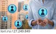 Купить «Profile contact icons and Businesswoman with hands palm open in city», фото № 27249849, снято 21 марта 2019 г. (c) Wavebreak Media / Фотобанк Лори