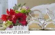 Купить «Flowers, sandals, wedding ring and necklace on the chair 4K 4k», видеоролик № 27253013, снято 15 октября 2019 г. (c) Wavebreak Media / Фотобанк Лори