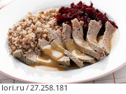 Купить «Boiled meat with buckwheat porridge», фото № 27258181, снято 26 ноября 2017 г. (c) Stockphoto / Фотобанк Лори