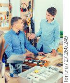 father and teen son working with wood plank in workshop. Стоковое фото, фотограф Яков Филимонов / Фотобанк Лори