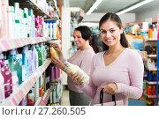 Купить «Two women choosing shampoo», фото № 27260505, снято 11 декабря 2017 г. (c) Яков Филимонов / Фотобанк Лори
