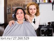 Купить «Mature woman likes very much her hairdress», фото № 27260529, снято 7 марта 2017 г. (c) Яков Филимонов / Фотобанк Лори
