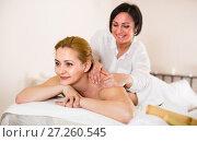 Купить «Young female is happy with procedure massage in beauty parlor», фото № 27260545, снято 7 марта 2017 г. (c) Яков Филимонов / Фотобанк Лори