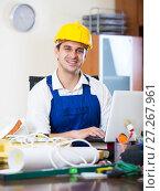 Купить «Professional builder preparing for call in design office», фото № 27267961, снято 25 мая 2019 г. (c) Яков Филимонов / Фотобанк Лори