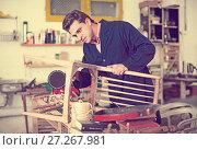 Купить «Man carpenter in furniture repair workshop», фото № 27267981, снято 8 апреля 2017 г. (c) Яков Филимонов / Фотобанк Лори