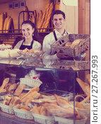 Купить «Friendly man and woman selling pastry and loaves», фото № 27267993, снято 4 июля 2020 г. (c) Яков Филимонов / Фотобанк Лори