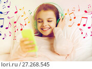 Купить «girl with headphones listening to music in bed», фото № 27268545, снято 6 декабря 2015 г. (c) Syda Productions / Фотобанк Лори