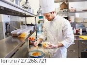 Купить «happy male chef cooking food at restaurant kitchen», фото № 27268721, снято 2 апреля 2017 г. (c) Syda Productions / Фотобанк Лори