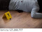 Купить «bullet and dead woman body on floor at crime scene», фото № 27268777, снято 5 мая 2017 г. (c) Syda Productions / Фотобанк Лори