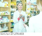 Купить «Seller helping customer to choose care products», фото № 27270833, снято 15 марта 2017 г. (c) Яков Филимонов / Фотобанк Лори