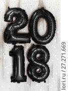 Купить «Bright metallic black balloons figures 2018, Christmas, New Year Balloon with glitter stars on white wood table background», фото № 27271669, снято 19 ноября 2017 г. (c) Сергей Тимофеев / Фотобанк Лори