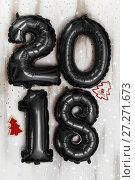 Купить «Bright metallic black balloons figures 2018, Christmas, New Year Balloon with glitter stars on white wood table background», фото № 27271673, снято 19 ноября 2017 г. (c) Сергей Тимофеев / Фотобанк Лори