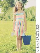 Купить «girl with bucket outdoors», фото № 27272325, снято 19 июня 2019 г. (c) Яков Филимонов / Фотобанк Лори