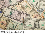 Купить «Background of different dollar bills», фото № 27273945, снято 7 декабря 2017 г. (c) Юлия Бабкина / Фотобанк Лори