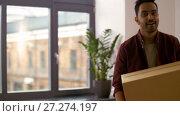 Купить «happy man with box moving to new home and dancing», видеоролик № 27274197, снято 30 ноября 2017 г. (c) Syda Productions / Фотобанк Лори