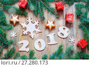 Купить «Happy New Year 2018 background with 2018 figures, Christmas toys, blue fir tree branches. New Year 2018 still life», фото № 27280173, снято 29 ноября 2016 г. (c) Зезелина Марина / Фотобанк Лори
