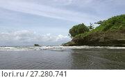 Купить «View of the sea, stones and the beach in the area Balian Beach.Bali Indonesia», видеоролик № 27280741, снято 12 октября 2009 г. (c) Куликов Константин / Фотобанк Лори