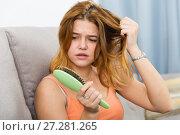 Girl in a panic because her hair falls out. Стоковое фото, фотограф Яков Филимонов / Фотобанк Лори