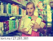 Купить «Happy girl holding shampoo and shower gel», фото № 27281381, снято 5 августа 2017 г. (c) Яков Филимонов / Фотобанк Лори