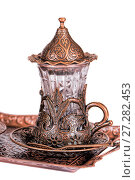 Купить «Turkish tea set. Ottoman teacup with traditional arabic ornaments on white background», фото № 27282453, снято 27 декабря 2015 г. (c) Евгений Ткачёв / Фотобанк Лори