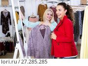 Купить «Female customers selecting coats and jackets», фото № 27285285, снято 25 апреля 2019 г. (c) Яков Филимонов / Фотобанк Лори