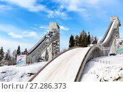 Купить «Continental Cup ski jumping. Height of 120 meters springboard», фото № 27286373, снято 17 марта 2017 г. (c) Евгений Ткачёв / Фотобанк Лори