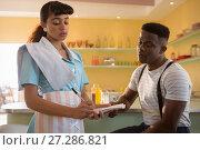 Купить «Waitress taking order in restaurant», фото № 27286821, снято 17 августа 2017 г. (c) Wavebreak Media / Фотобанк Лори