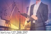 Купить «Businessman on background of crane», фото № 27288297, снято 19 июля 2012 г. (c) Яков Филимонов / Фотобанк Лори
