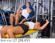 Купить «woman making bench press exercise from supine position using gym machinery indoors», фото № 27288653, снято 20 ноября 2018 г. (c) Яков Филимонов / Фотобанк Лори