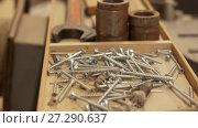 Купить «wood screws and tools in box at workshop», видеоролик № 27290637, снято 17 ноября 2017 г. (c) Syda Productions / Фотобанк Лори
