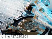 Купить «Server hard disks, illuminated optical fiber with blurred lights», фото № 27290801, снято 22 июля 2018 г. (c) Mikhail Starodubov / Фотобанк Лори